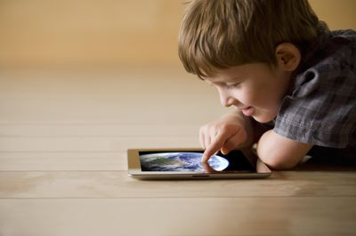 kid and ipad on the floor